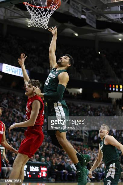 Kenny Goins of the Michigan State Spartans takes a shot over Brady Heiman of the Nebraska Cornhuskers during the first half at Breslin Center on...