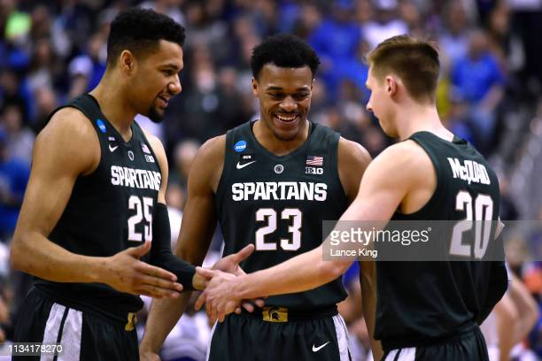 Kenny Goins Xavier Tillman and Matt McQuaid of the Michigan State Spartans huddle prior to their game against the Duke Blue Devils during the 2019...