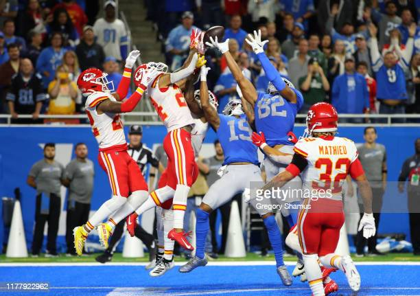 Kenny Golladay and Logan Thomas of the Detroit Lions try to pull in a last second touchdown in front of Jordan Lucas and Juan Thornhill of the Kansas...