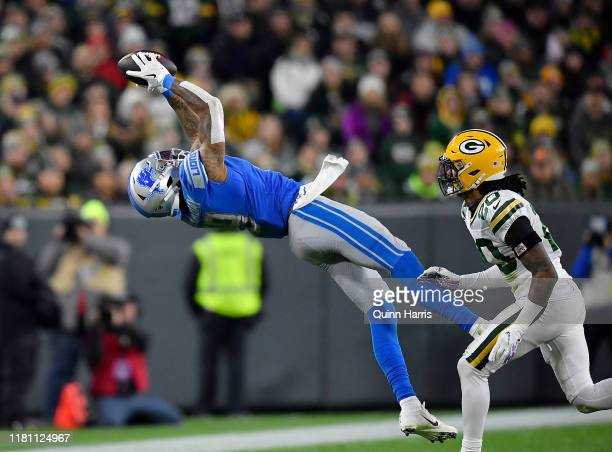 Kenny Golladay of the Detroit Lions attempts a catch in the third quarter Kevin King of the Green Bay Packers at Lambeau Field on October 14 2019 in...