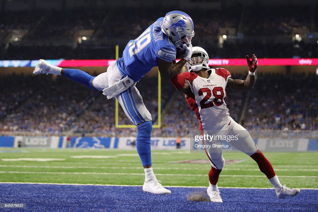 Kenny Golladay #19 of the Detroit Lions catches a fourth quarter touchdown next to Justin Bethel #28 of the Arizona Cardinals at Ford Field on September 10, 2017 in Detroit, Michigan. Detroit won the game 35-23.