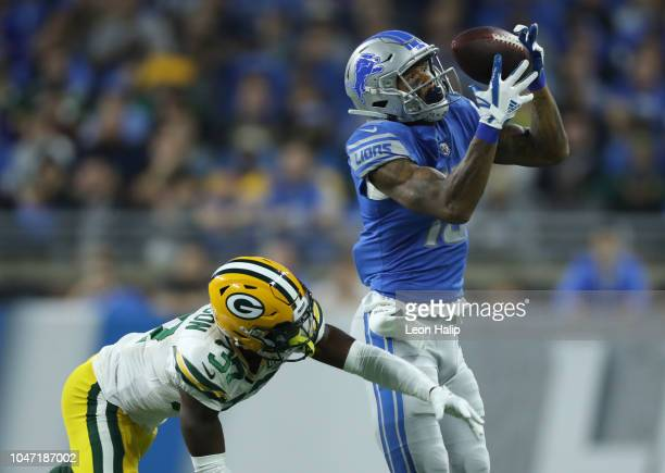 Kenny Golladay of the Detroit Lions catches a pass against Josh Jackson of the Green Bay Packers during the first half at Ford Field on October 7...