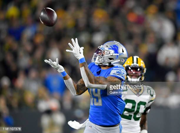 Kenny Golladay of the Detroit Lions catches a pass in the first quarter Kevin King of the Green Bay Packers at Lambeau Field on October 14 2019 in...