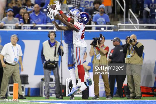 Kenny Golladay of the Detroit Lions catches a second quarter touchdown pass in front of Deandre Baker of the New York Giants at Ford Field on October...
