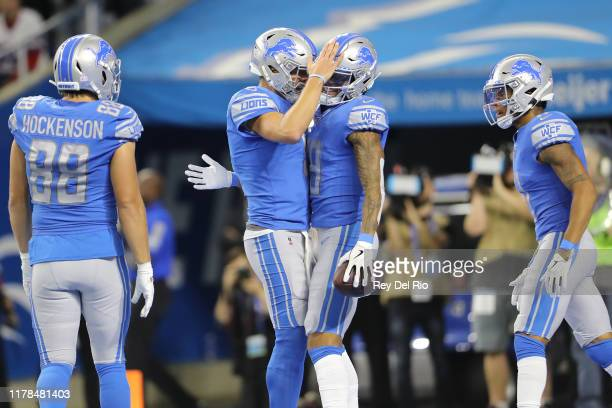 Kenny Golladay of the Detroit Lions celebrates his touchdown pass with teammate Matthew Stafford of the Detroit Lions in the third quarter against...