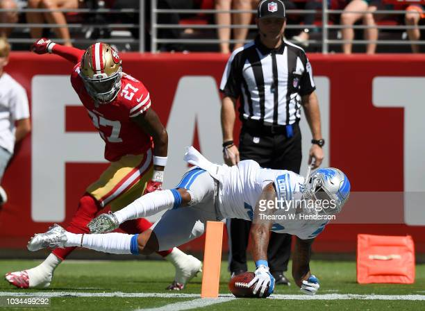 Kenny Golladay of the Detroit Lions dives for a touchdown against the San Francisco 49ers during the first quarter of their NFL football game at...