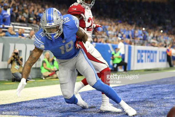 Kenny Golladay of the Detroit Lions fumbles the ball in the second half of the game against the Arizona Cardinals at Ford Field on September 10 2017...