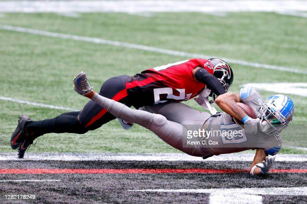 Kenny Golladay of the Detroit Lions is tackled by Kendall Sheffield of the Atlanta Falcons after making a reception during the first half at...