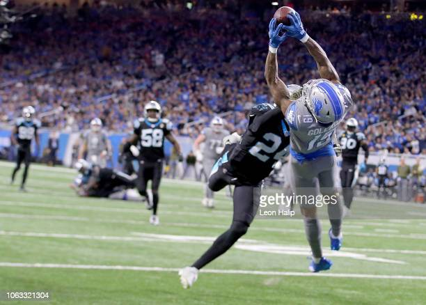 Kenny Golladay of the Detroit Lions makes a diving catch against James Bradberry of the Carolina Panthers during the fourth quarter at Ford Field on...