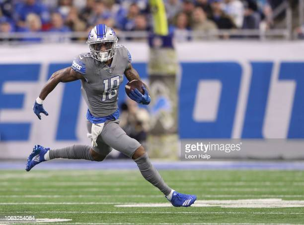 Kenny Golladay of the Detroit Lions makes the catch and runs for a short gain during the first quarter of the game against the Carolina Panthers at...