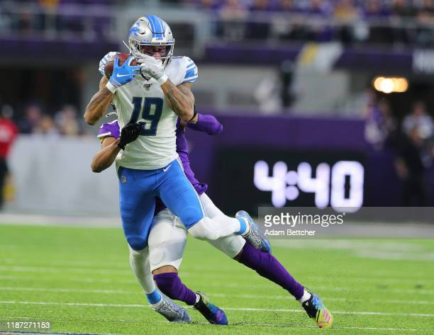 Kenny Golladay of the Detroit Lions pulls in a catch while Mike Hughes of the Minnesota Vikings makes the tackle in the second quarter at US Bank...