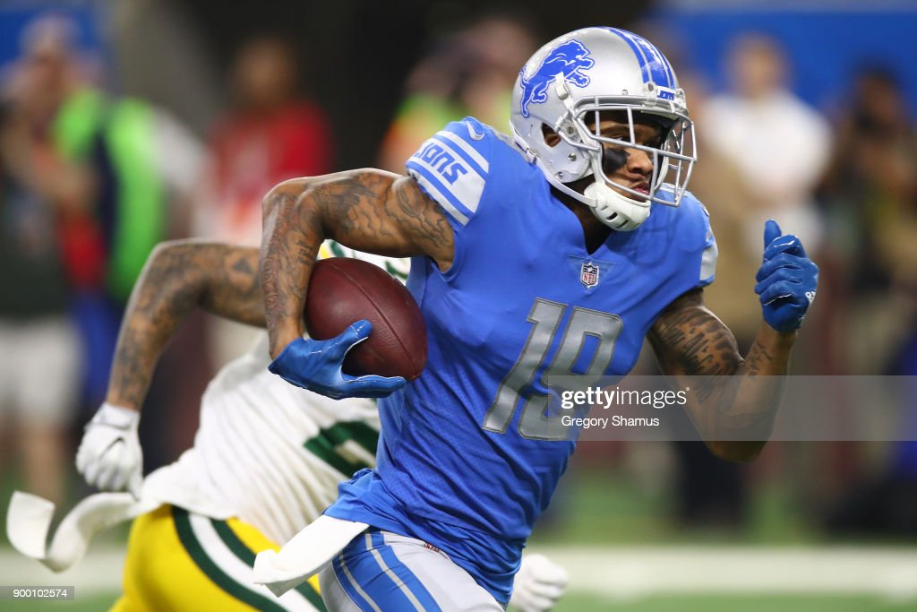 Kenny Golladay #19 of the Detroit Lions runs for a touchdown after catching a pass from Matthew Stafford #9 of the Detroit Lions against the Green Bay Packers during the first half at Little Caesars Arena on December 29, 2017 in Detroit, Michigan.
