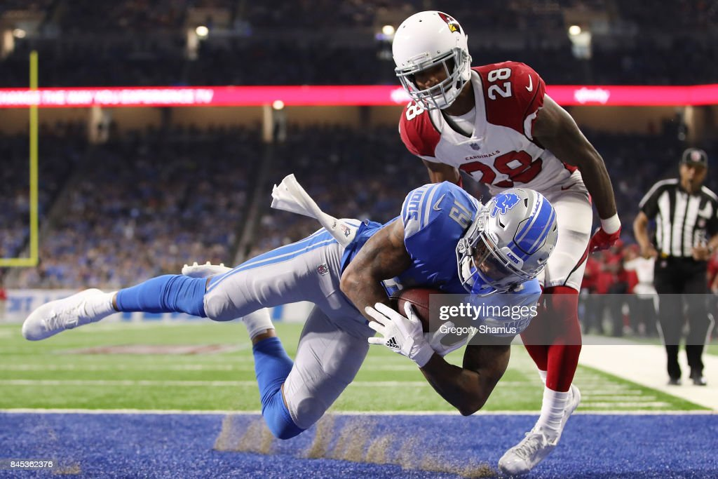 Kenny Golladay #19 of the Detroit Lions scores a touch down in the second half against Justin Bethel #28 of the Arizona Cardinals at Ford Field on September 10, 2017 in Detroit, Michigan.
