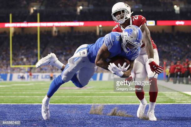 Kenny Golladay of the Detroit Lions scores a touch down in the second half against Justin Bethel of the Arizona Cardinals at Ford Field on September...