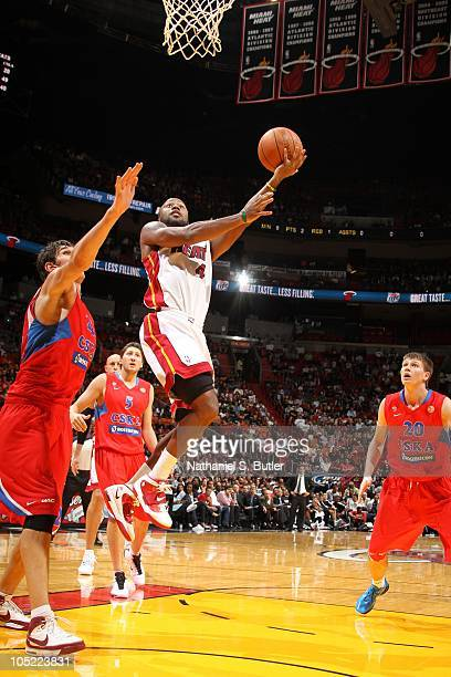 Kenny Hasbrouck of the Miami Heat shoots against Boban Marjanovic of CSKA Moscow during a game on October 12 2010 at American Airlines Arena in Miami...