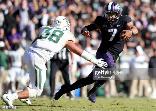 Kenny Hill of the TCU Horned Frogs carries the ball against Jordan Williams of the Baylor Bears in the second half at Amon G Carter Stadium on...