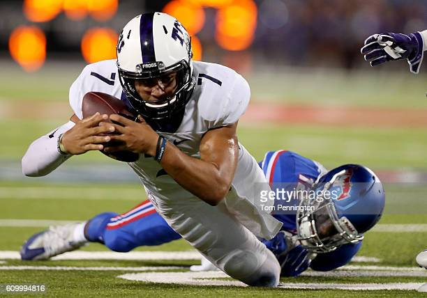 Kenny Hill of the TCU Horned Frogs carries the ball against Kevin Johnson of the Southern Methodist Mustangs in the second quarter at Gerald J Ford...