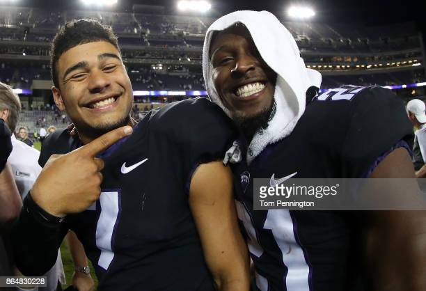 Kenny Hill of the TCU Horned Frogs celebrates with Kyle Hicks of the TCU Horned Frogs after the TCU Horned Frogs beat the Kansas Jayhawks 430 at Amon...