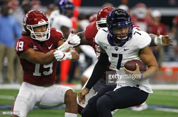 Kenny Hill of the TCU Horned Frogs is pursued by Caleb Kelly and Du'Vonta Lampkin of the Oklahoma Sooners in the first half of the Big 12...