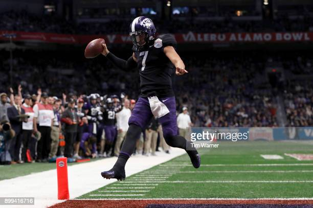 Kenny Hill of the TCU Horned Frogs scrambles for a touchdown in the second quarter against the Stanford Cardinal during the Valero Alamo Bowl at the...