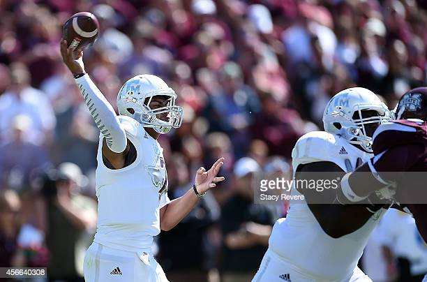 Kenny Hill of the Texas AM Aggies looks to pass against the Mississippi State Bulldogs during the first quarter of a game at Davis Wade Stadium on...