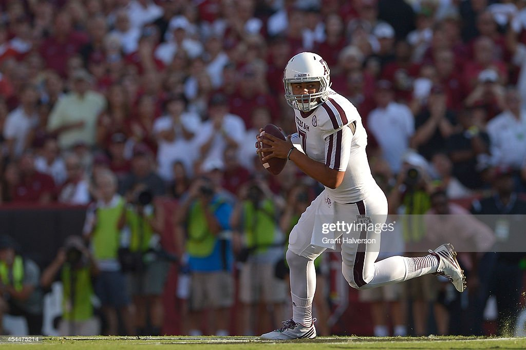 Kenny Hill #7 of the Texas A&M Aggies throws against the South Carolina Gamecocks during their game at Williams-Brice Stadium on August 28, 2014 in Columbia, South Carolina. Texas A&M won 52-28.