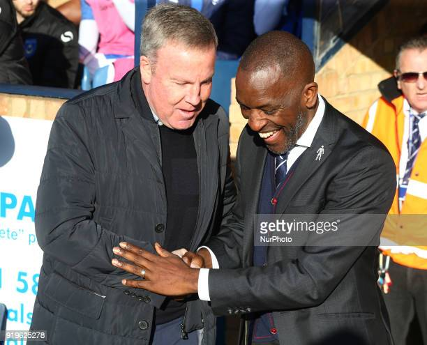 LR Kenny Jackett manager of Portsmouth shanks hands with Chris Powell manager of Southend United during League One match between Southend United...