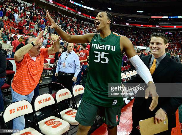 Kenny Kadji of the Miami Hurricanes celebrates with fans after a last-second win over the North Carolina State Wolfpack at PNC Arena on February 2,...