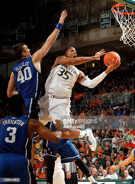 Kenny Kadji of the Miami Hurricanes goes to the basket past Marshall Plumlee of the Duke Blue Devils on January 23 2013 at the BankUnited Center in...