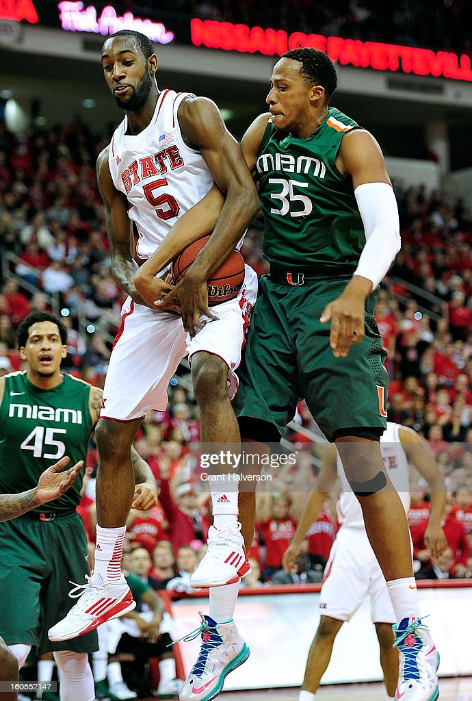 Kenny Kadji #35 of the Miami Hurricanes ties up with C.J. Leslie #5 of the North Carolina State Wolfpack as they battle for a rebound during play at PNC Arena on February 2, 2013 in Raleigh, North Carolina.