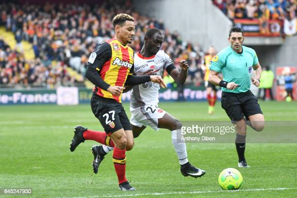 Kenny Lala of Lens and Saliou Ciss of Valenciennes during the French Ligue 2 match between Lens and Valenciennes at Stade BollaertDelelis on February...