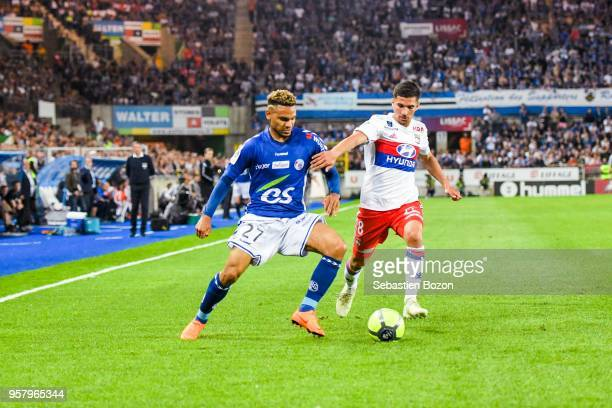 Kenny Lala of Strasbourg and Houssem Aouar of Lyon during the Ligue 1 match between Strasbourg and Olympique Lyonnais on May 12 2018 in Strasbourg