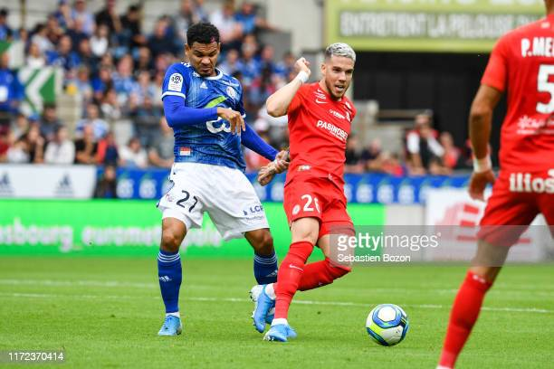 Kenny LALA of Strasbourg and Mihailo RISTIC of Montpellier during the Ligue 1 match between Strasbourg and Montpellier on September 29 2019 in...