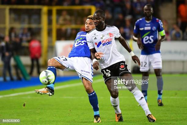 Kenny Lala of Strasbourg and Moussa Donate of Amiens during the Ligue 1 match between Strasbourg and Amiens SC at on September 9 2017 in Strasbourg...