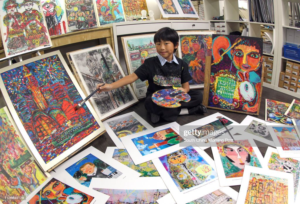 Kenny Lau Kin-gi, an 8-year-old artist, poses for pictures with his