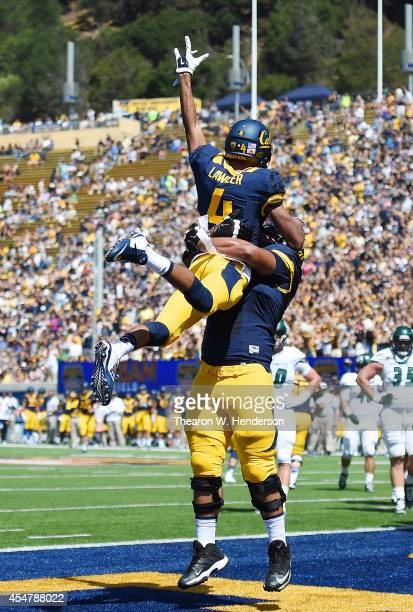 Kenny Lawler and Chris Borrayo of the California Golden Bears celebrates after Lawler caught a four yard touchdown pass against the Sacramento State...