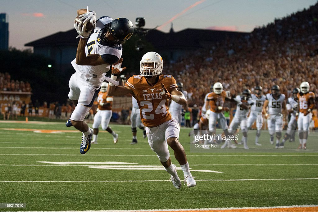 Kenny Lawler #4 of the California Golden Bears catches a 17-yard touchdown pass against the Texas Longhorns during the second quarter on September 19, 2015 at Darrell K Royal-Texas Memorial Stadium in Austin, Texas.