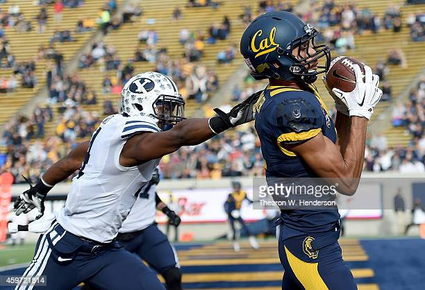 Kenny Lawler of the California Golden Bears catches a touchdown pass over Robertson Daniel of the Brigham Young Cougars during the second quarter at...