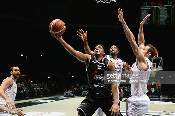 Kenny Lawson of Segafredo competes with Tommaso Rinaldi Jesse Perry and Andrea La Torre of De Longhi during the LegaBasket Serie A2 LNP match between...
