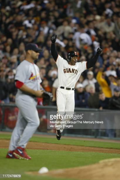 SIMON Kenny Lofton leaps for joy after he saw teammate David Bell score from second base on his single The win secured the National League pennant...