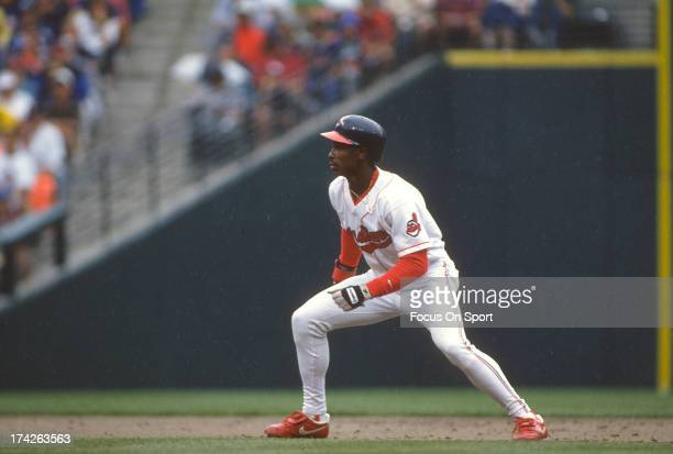 Kenny Lofton of the Cleveland Indians leads off of second base during an Major League Baseball game circa 1994 at Cleveland Stadium in Cleveland Ohio...