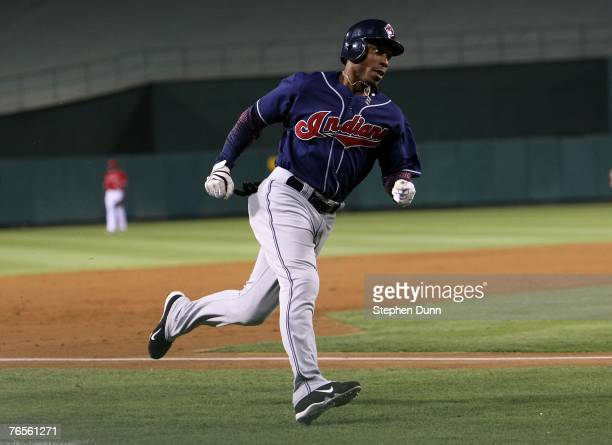 Kenny Lofton of the Cleveland Indians rounds third on his way to scoring the first of the game against the Los Angeles Angels of Anaheim on September...