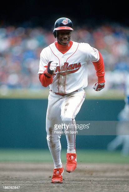 Kenny Lofton of the Cleveland Indians runs the bases during an Major League Baseball game circa 1995 at Cleveland Stadium in Cleveland Ohio Lofton...