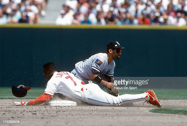 Kenny Lofton of the Cleveland Indians slides head first stealing second base against the Chicago White Sox during an Major League Baseball game circa...