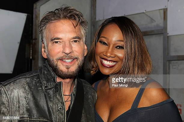 Kenny Loggins and Yolanda Adams pose for a photo backstage during A Capitol Fourth concert at the US Capitol West Lawn on July 4 2016 in Washington DC