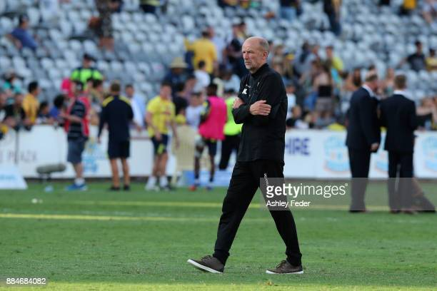 Kenny Lowe coach of the Glory looks dejected after losing during the round nine ALeague match between the Central Coast Mariners and Perth Glory at...