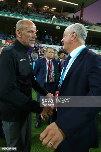 Kenny Lowe head coach of the Glory and Graham Arnold head coach of Sydney shakes hands before the round 25 ALeague match between the Perth Glory and...