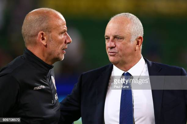 Kenny Lowe head coach of the Glory and Graham Arnold head coach of Sydney talk following the round 25 ALeague match between the Perth Glory and...