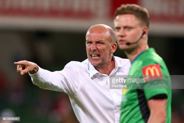 Kenny Lowe head coach of the Glory reacts as the fourth official Adam Fielding look son during the round 15 ALeague match between the Perth Glory and...