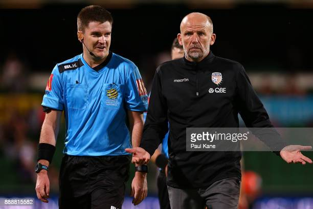 Kenny Lowe head coach of the Glory talks with referee Adam Kersey after the final whistle during the round 10 ALeague match between the Perth Glory...